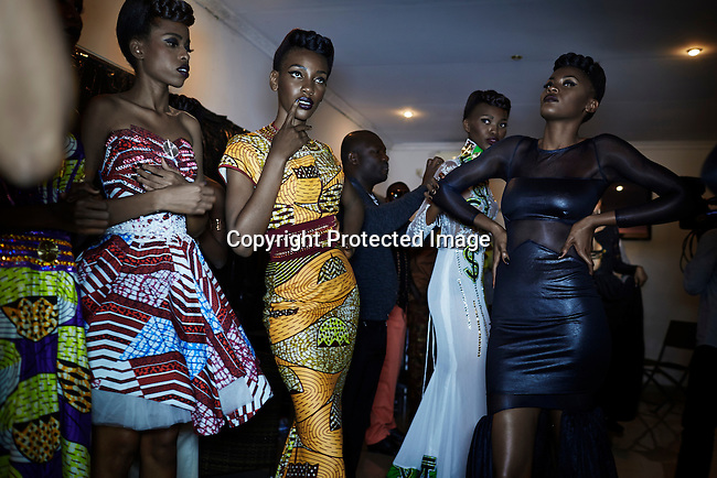 KINSHASA, DRC - JULY 19: Fashion models wait backstage before a show Kinshasa Fashion Week on July 19, 2014, at Shark club in Kinshasa, DRC. Local and invited foreign-based designers showed their collections during the second edition of Kinshasa Fashion week. Vanessa Nsul Kilem, age 21 (c) was one of about 2000 models who casted for the chance to participate in the fashion week. She was one of the thirty who was selected. Photo by Per-Anders Pettersson)