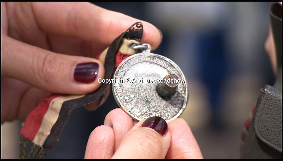 BNPS.co.uk (01202 558833)<br /> Pic: AntiquesRoadshow/BNPS<br /> <br /> ***Please Use Full Byline***<br /> <br /> The medal which was in the purse which the bullet struck saving the mans life. <br /> <br /> This extraordinary relic of the First World War shows how a humble medal saved a German soldier's life by stopping a British bullet aimed at his chest.<br /> <br /> The round fired from a Lee Enfield rifle pierced through the middle of the 2ins silver medal and jammed tight, leaving the front and back of it protruding like a spinning top.<br /> <br /> The item will feature on this Sunday's Antiques Roadshow on BBC1.