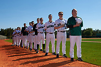 Dartmouth Big Green stand for the national anthem, lead by head coach Bob Whalen (right), coach Jonathan Anderson (11), coach Evan Wells (7), and coach Tyler Anderson (35) before a game against the Iowa Hawkeyes on February 27, 2016 at South Charlotte Regional Park in Punta Gorda, Florida.  Iowa defeated Dartmouth 4-1.  (Mike Janes/Four Seam Images)