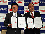 March 29, 2016, Tokyo, Japan - Japan Post Insurance president Masami Ishii (L) and Dai-ichi Life Insurance president Koichiro Watanabe show their documents on their agreement in Tokyo on Tuesday, March 29, 2016. Japan Post Insurance and Dai-ichi Life Insurance have reached basic agreement to form a strategic business alliance. (Photo by Yoshio Tsunoda/AFLO) LWX -ytd-