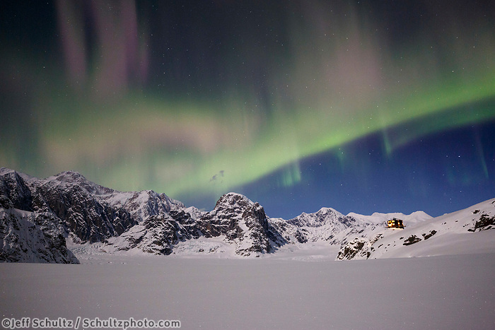 The Aurora Borealis, (aka Northern Lights) light up the sky over Denali and the Ruth Glacier and Amphitheater in the Alaska Range with the Sheldon Chalet.  Winter <br /> <br /> Photo by Jeff Schultz/SchultzPhoto.com  (C) 2017  ALL RIGHTS RESERVED