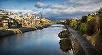 Kamo River, Kamo-gawa, with pathways along the banks and people fishing. Kyoto beautiful panoramic sunrise scenery from Shijoo bridge near Gion station with Sanjo bridge in the background in dramatic autumn morning light. Kyoto, Japan 2017.
