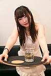 "Hime (19), one of the wives at the Ore no Yome cafe, poses for a photograph in Ikebukuro on November 4, 2015, Tokyo, Japan. ""Ore no Yome"" which literally means ''My Wife'' is one of the latest bizarre cafe concepts in Tokyo where wives wearing bikinis and an apron welcome you by your first name and serve drinks and dinner. The cafe is aimed at weary salarymen wanting a little comfort after work, although it also employs male staff who wear tight shorts and will act as your ""darling"" for the evening for female customers. According to the owner, the cafe will close its doors on Friday November 6, 2015, but there are still plenty of other bizarre establishments in the area. (Photo by Rodrigo Reyes Marin/AFLO)"