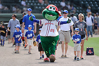 Mascot Reedy Rip'It of the Greenville Drive leads a parade of youth ballplayers before a game against the Lexington Legends on Sunday, April 27, 2014, at Fluor Field at the West End in Greenville, South Carolina. Greenville won, 21-6. (Tom Priddy/Four Seam Images)