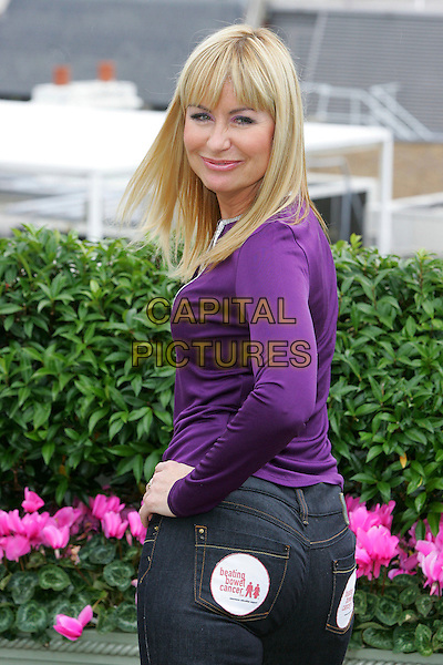 SIAN LLOYD.Rear Of The Year Awards 2007, The Dorchester, London, England..September 19th, 2007.half length purple top beating bowel cancer badge jeans denim looking over shoulder.CAP/ROS.©Steve Ross/Capital Pictures