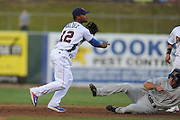 Tennessee Smokies shortstop Jeudy Valdez #12 completes a double play over a hard sliding Josh Prince #14 as Stephen Bruno #11 watches during a game against Huntsville Stars at Smokies Park on April 25, 2014 in Kodak, Tennessee. The Stars defeated the Smokies 15-1. (Tony Farlow/Four Seam Images)