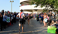 Athletes run up the parking ramp after the swim leg of the 2017 IRONMAN Wisconsin on Sunday, September 10 in Madison