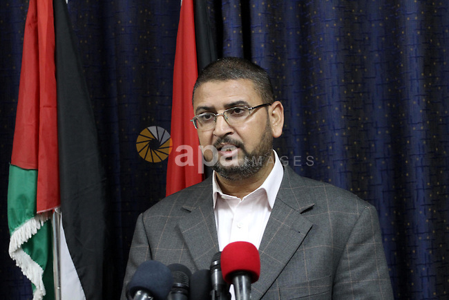 Spokesman of Hamas movement in Gaza Strip, Sami Abu Zuhri, speaks during a press conference in Gaza city on November 9, 2014. Palestinian Authority chief Mahmoud Abbas' Fatah movement said Sunday it is cancelling this week's Gaza ceremonies marking the 10th anniversary of Yasser Arafat's death due to security concerns. Gaza-based Fatah spokesman Fayez Abu Eita said that Hamas said it could not guarantee security at the memorial events scheduled for Tuesday . Photo by Mohammed Asad
