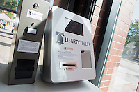 A Liberty Teller bitcoin ATM stands in the entryway of the COOP at MIT in Kendall Square in Cambridge, Massachusetts, USA. Using the machine, customers can buy bitcoins and store them in a paper wallet. Bitcoin is virtual currency.