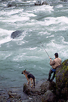 Fisherman fishing with his Dog