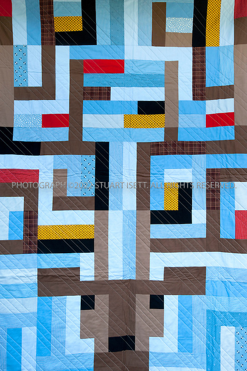 8/4/2010--Seattle, WA, USA..Boo Davis, a Seattle-based quiltmaker. She sells her work through her company 'Quiltsrÿche'. Davis makes modern, heirloom quilts, often with heavy metal and rock motifs. 'http://www.quiltsryche.com/..©2010 Stuart Isett. All rights reserved.