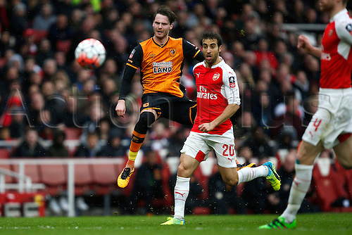 20.02.2016. The Emirates, London, England. Emirates FA Cup 5th Round. Arsenal versus Hull City. Nick Powell of Hull fires a shot at goal as Mathieu Flamini of Arsenal watches on.