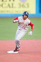 Jhoan Urena (13) of the Brooklyn Cyclones rounds the bases after hitting a game tying home run in the top of the 9th inning against the Hudson Valley Renegades at Dutchess Stadium on June 18, 2014 in Wappingers Falls, New York.  The Cyclones defeated the Renegades 4-3 in 10 innings.  (Brian Westerholt/Four Seam Images)