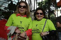 SAO PAULO - SP - 08 DE JUNHO DE 2013 - CAMPANHA AGASALHO, 2ª Caminhada da Solidariedade da ACM São Paulo em prol da Campanha do Agasalho, aconteceu neste sábado (8) na Praça dos Omaguás - Pinheiros - zona oeste de São Paulo e percorreu as ruas da região coletando doações.  Sra. Maria José Volpe Arouca - Presidente da ACM/YMCA-SP(d) e Sr. Marisia Donatelli - Secr. Geral SCM/YMCA-SP (e) . FOTO: MAURICIO CAMARGO / BRAZIL PHOTO PRESS.