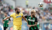 Calcio, Serie A: Reggio Emilia, Mapei stadium, 17 settembre 2017.<br /> Sassuolo's Timo Letschert (r) in action with Juventus' Gonzalo Higuain (l) during the Italian Serie A football match between Sassuolo and Juventus at Reggio Emilia's Mapei stadium, September 17, 2017.<br /> UPDATE IMAGES PRESS/Isabella Bonotto