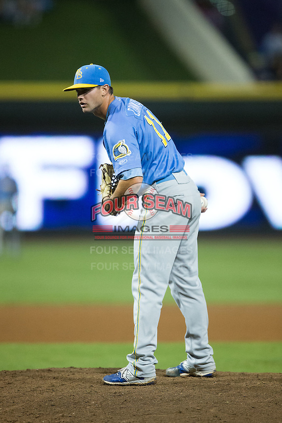 Myrtle Beach Pelicans relief pitcher Josh Conway (11) looks to his catcher for the sign against the Winston-Salem Dash at BB&T Ballpark on August 20, 2015 in Winston-Salem, North Carolina.  The Dash defeated the Pelicans 5-4 on a walk-off wild pitch in the bottom of the 9th inning.  (Brian Westerholt/Four Seam Images)