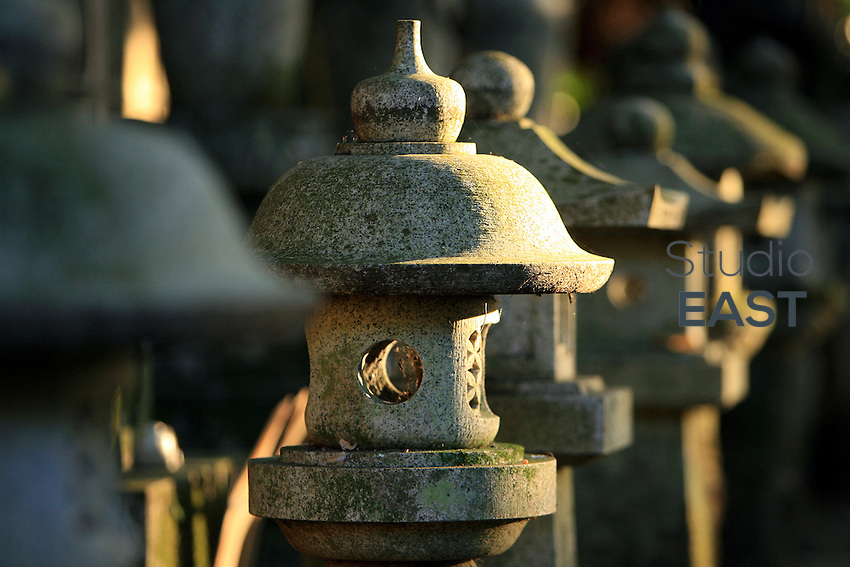 Rays of sun on a graveyard in Kyoto, Japan, on November 8, 2006. Kyoto is the former imperial capital of Japan, and today houses more than 1.5 million. Photo by Lucas Schifres/Pictobank