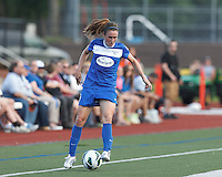 Boston Breakers midfielder Heather O'Reilly (9) collects a pass.  In a National Women's Soccer League (NWSL) match, Boston Breakers (blue) defeated Sky Blue FC (white), 3-2, at Dilboy Stadium on June 30, 2013.