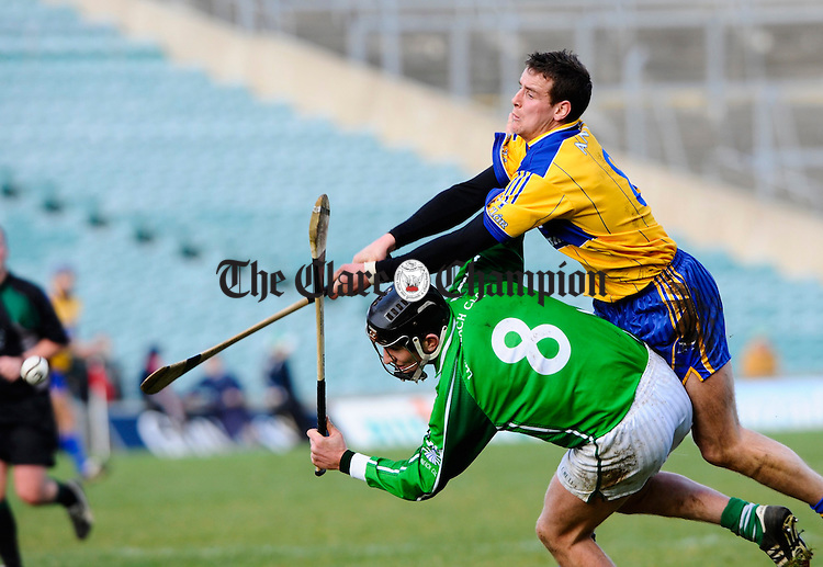 Clare's Brian O Connell contests a ball with Limerick's Donal O Grady during their National League game in Limerick. Photograph by John Kelly.