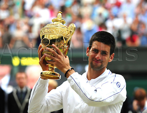 03.07.2011 London England. Mens singles final. Novak Djokovic versus Rafael Nadal. Picture shows Novak Djokovic of Serbia Celebrating with the trophy After Winning his first Wimbledon title.