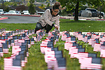 Sierra Shaw, members of the Western Nevada College Veterans Resource Center and other volunteers plant thousands of American flags at WNC, in Carson City, Nev. on Friday, May 6, 2016. The flags represent the more than 8,000 veterans who commit suicide each year.   <br /> Photo by Cathleen Allison/Nevada Photo Source