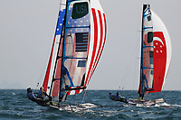 RIO DE JANEIRO, BRAZIL - AUGUST 15:  Paris Henken (helm) of the United States and Helena Scutt of the United States  compete during their Women's 49er FX class race on Day 10 of the Rio 2016 Olympic Games at the Marina da Gloria on August 15, 2016 in Rio de Janeiro, Brazil.  (Photo by Clive Mason/Getty Images)