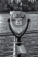 A coin operated binocular viewer in Gantry Plaza State Park in Long Island City, Queens, New York offering views of Manhattan across the East River.