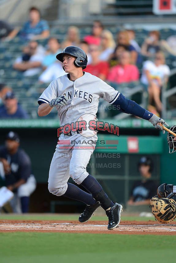 Tampa Yankees third baseman Peter O'Brien (27) hits a home run during a game against the Jupiter Hammerheads on July 17, 2013 at Roger Dean Stadium in Jupiter, Florida.  Jupiter defeated Tampa 4-3.  (Mike Janes/Four Seam Images)