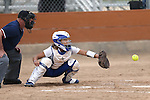 Wildcats' Bailey Henderson works behind the plate against Snow College at Edmonds Sports Complex in Carson City, Nev., on Friday, March 20, 2015. <br /> Photo by Cathleen Allison