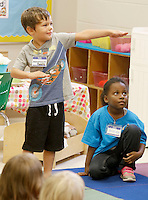 "NWA Democrat-Gazette/DAVID GOTTSCHALK  Benjamin ""Paddle"" Hurley, an upcoming kindergarten student, demonstrates ninja moves and personal space during Kindergarten Kamp Tuesday, August 5, 2015 at Washington Elementary School in Fayetteville. The three day camp was an opportunity for children to to rotate through and acclimate with the many different activities associated with school."