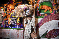 A woman donning make up inspired by the Mexican Day of The Dead spirit poses for a photograph during the 41st Annual Halloween Parade. 10.31.2014. Photo by Marco Aurelio/VIEWpress