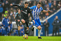 Eden Hazard of Chelsea (10) and Dale Stephens of Brighton & Hove Albion (6)  challenge for the ball  during the Premier League match between Brighton and Hove Albion and Chelsea at the American Express Community Stadium, Brighton and Hove, England on 20 January 2018. Photo by Edward Thomas / PRiME Media Images.