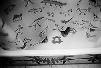 Switzerland. Canton Ticino. Massagno. Shower curtain with animals. Wet feet. © 2007 Didier Ruef