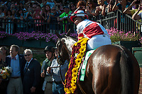 WILMINGTON, DE - JULY 15: Songbird #5, ridden by Mike Smith, in the winner's circle the G1 Delaware Handicap at Delaware Park in Wilmington, Delaware. (Photo by Sophie Shore/Eclipse Sportswire/Getty Images)