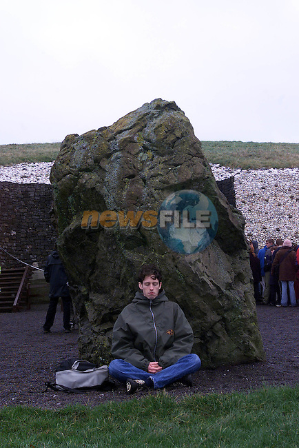 Drew McNulty from Redding in England travelled over for the Winter Solstice seen meditating at Newgrange monument...Pic Fran Caffrey Newsfile..Camera:   DCS620C.Serial #: K620C-01974.Width:    1152.Height:   1728.Date:  21/12/00.Time:   8:31:04.DCS6XX Image.FW Ver:   3.0.9.TIFF Image.Look:   Product.Sharpening Requested: No.Tagged.Counter:    [13528].Shutter:  1/60.Aperture:  f6.3.ISO Speed:  400.Max Aperture:  f2.8.Min Aperture:  f22.Focal Length:  35.Exposure Mode:  Manual (M).Meter Mode:  Color Matrix.Drive Mode:  Continuous High (CH).Focus Mode:  Single (AF-S).Focus Point:  Center.Flash Mode:  Normal Sync.Compensation:  +0.0.Flash Compensation:  +0.0.Self Timer Time:  5s.White balance: Preset (Flash).Time: 08:31:04.569.