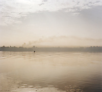 Local fisherman on a papyrus reed boat, otherwise known as a Tankwa, Lake Tana, North West Ethiopia