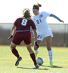 SIOUX FALLS, SD - OCTOBER 11: Ciara Howerton #21 from the University of Sioux Falls tries top make a move against Rachelle Alcini #8 from Minnesota Crookston in the first half of their game Saturday in Sioux Falls. (Photo by Dave Eggen/Inertia)