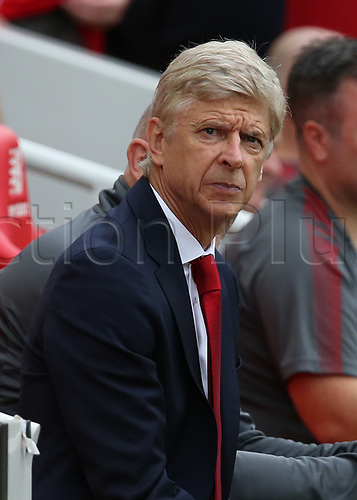 27th August 2017, Anfield, Liverpool, England; EPL Premier League football, Liverpool versus Arsenal; Arsene Wenger , manager of Arsenal looks on from his seat in the away team dugout