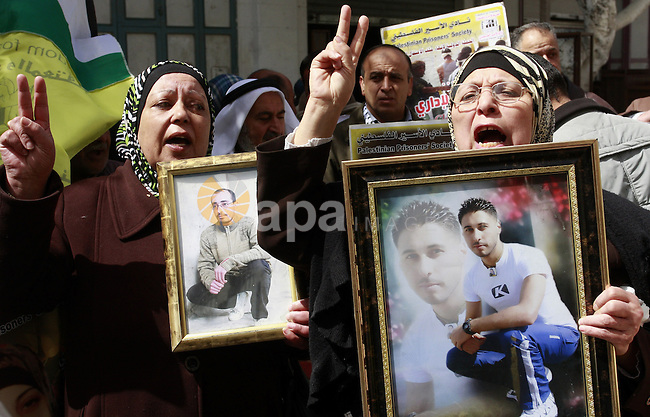 Palestinian women hold portraits of jailed compatriot Hana Shalabi, a female Palestinian prisoner jailed in Israel who has been on hunger strike for 33 days, outside the Red Cross building in the West Bank city of Nablus, 19 March 2012. Palestinian sources said that Shalabi is protesting against the Israeli administrative detention, which apparently is a law imposed against Palestinian prisoners under which they can be detained for months without a charge or trial.  Photo by Wagdi Eshtayah