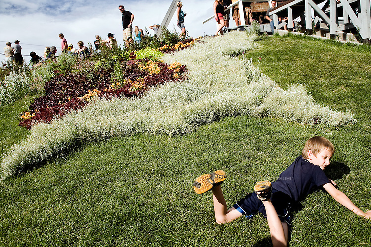 A child plays in the grass during Evel Knievel Days in Butte, Montana, USA.