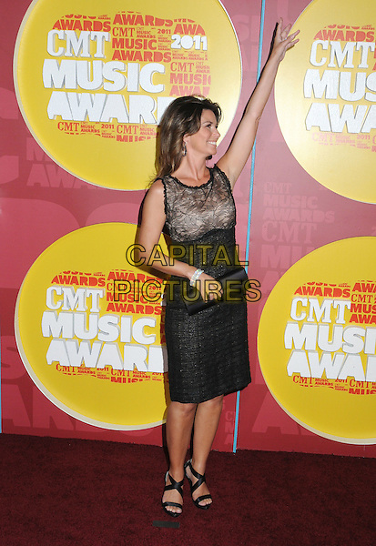 Shania Twain.2011 CMT Music Awards held at Bridgestone Arena, Nashville, Tennessee, USA..June 8th, 2011.full length sleeveless shift dress smiling black beige lace sandals clutch bag open toe tweed side profile arm in air.CAP/ADM/LF.©Laura Farr/AdMedia/Capital Pictures.