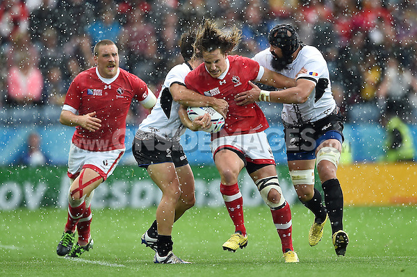 Jeff Hassler of Canada takes on the Romania defence Rugby World Cup Pool D match between Canada and Romania on October 6, 2015 at Leicester City Stadium in Leicester, England. Photo by: Patrick Khachfe / Onside Images