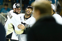 Brian Dumoulin #8 and Matt Cullen #7 of the Pittsburgh Penguins share a moment following their 3-1 win against the San Jose Sharks during game six of the Stanley Cup Final at SAP Center in San Jose, California on June 12, 2016. (Photo by Jared Wickerham / DKPS)