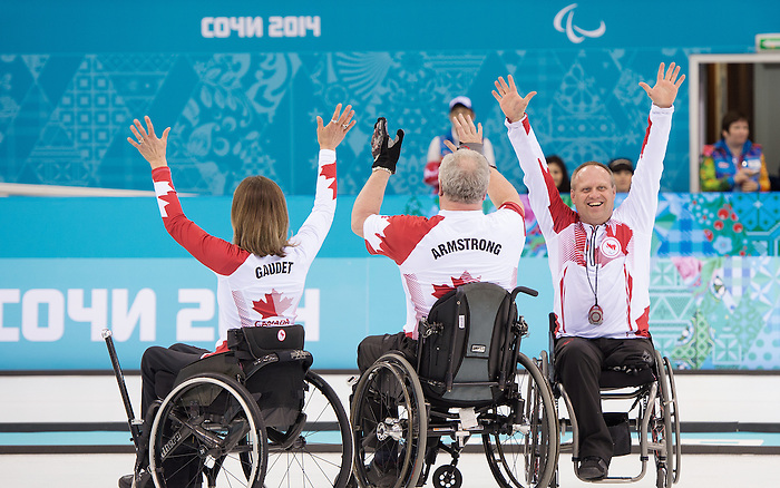 Sochi, RUSSIA - Mar 15 2014 - Sonja Gaudet,Jim Armstrong and Dennis Thiessen celebrate their gold medal win in the Gold Medal Wheechair Curling match at the 2014 Paralympic Winter Games in Sochi, Russia.  (Photo: Matthew Murnaghan/Canadian Paralympic Committee)