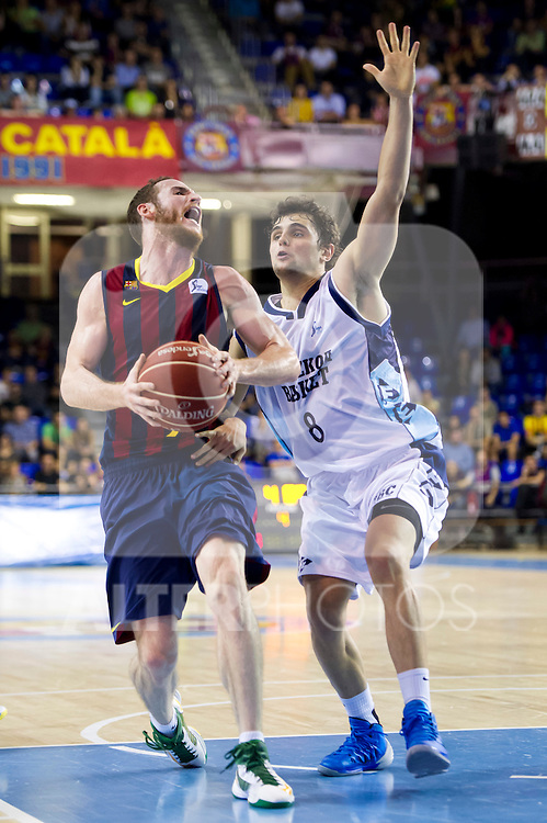 FC Barcelona's Marcelinho Huertas (left) and Gipuzkoa Basket Club's Raul Togni Neto (right) during Liga Endesa ACB 2013-2014 match. November 3, 2013. (ALTERPHOTOS/Alex Caparros)