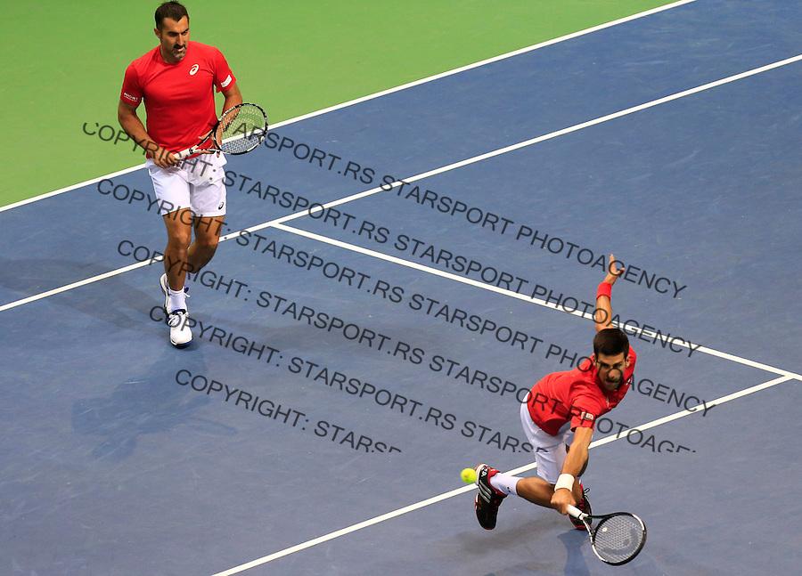 Davis Cup 2014 first round<br /> Srbija v Hrvatska<br /> Novak Djokovic and Nenad Zimonjic-Serbia v Franko Skugor and Marin Draganja doubles dublovi<br /> Novak Djokovic (R) and Nenad Zimonjic<br /> Kraljevo, 07.03.2015.<br /> Foto: Srdjan Stevanovic/Starsportphoto.com&copy;
