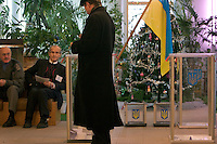 Kiev, Ukraine, 26/12/2004..The third and final round of Ukraine's disputed Presidential election. Election observers watch new clear perspex ballot boxes used in an attempt to prevent election fraud.