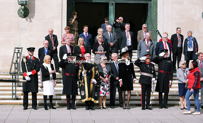 Pictured: Councillor Philip Downing (4th LEFT), H.M. Lord Lieutenant of West Glamorgan D Byron Lewis (8th L) and other dignitaries take a salute outside the Guild Hall, Swansea.  Friday 15 September 2017<br />