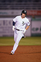 Tampa Yankees right fielder Austin Aune (21) runs the bases after hitting a home run during a game against the Lakeland Flying Tigers on April 8, 2016 at George M. Steinbrenner Field in Tampa, Florida.  Tampa defeated Lakeland 7-1.  (Mike Janes/Four Seam Images)
