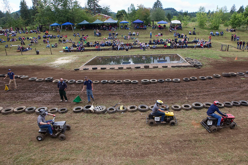 """A lawnmower race takes place at the annual """"Territorial Days"""" festival in Amboy Sunday July 10, 2016. Other events during the celebration included a logging show, musical performances, an art show and a carnival. The celebration highlights the area's connection to logging and pioneering.  (L to R) Lindsey Davis, Courtney Nicholson, Skylar Riggs, and Emily Hoffman. (Photo by Natalie Behring/ for the The Columbian)"""